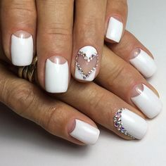 The Rhinestones' Heart on White Nails. If you are going on a romantic date with your loved one, nothing would suit more than this nail art that is enhanced with white rhinestones in the shape of heart.