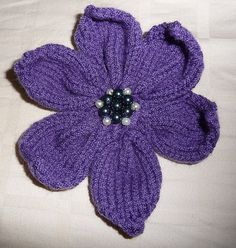 I joined a swap on brooch swap on ravelry and has been trying my hands on making a knitted flower. This is my first knitted pattern! :D Materials DK weight yarn 3.5mm needles (straight or circular,...                                                                                                                                                     More