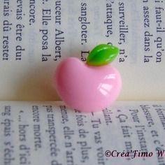 Jolie bague enfant pomme rose pâle en résine