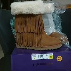 FINAL DAY SALE**Brand NEW **Madden Girl Boots Brand NEW Brown frindged madden girl boots with soft wool like fur around the top of the boot AS SHOWN IN PIC. These are so cute ..can be worn with skinny jeans cute leggins or a cute skirt..perfect for fall or winter.. These most definitely wont last.. Madden Girl Shoes Winter & Rain Boots