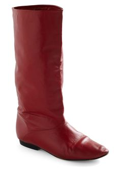 Exhibit your fresh style from the botanical garden to the outdoor bistro on the next block by flaunting these fresh vintage boots with a floral frock, wispy white tights, and your classic Diana camera! Crafted with a simple calf-high silhouette in a captivating shade of red, as well as a super-slim heel, this simple pair is an eye-popping complement to your natural charm.    Period: circa 1970s