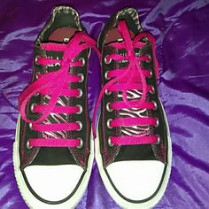 Converse Chuck Taylor Pink Black Zebra Shoes Sz 7 Here's a cute pair of Chucks or All Stars, whatever you like to call em.  They're used but still have plenty of life left in em.  Freshly washed.  Stamped size 5 which is a ladies 7.  Double tongues, top ones black with pink black zebra print on reverse, bottom one is hot pink backed with that same pink/black zebra print.  In good used shape, I just didn't wear them enough last summer to keep them for this upcoming one. Thanks for looking…