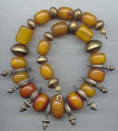 Old bronze and amber piece from Africa.