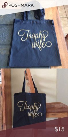 "Trophy Wife totes Cute & fun totes with saying ""Trophy Wife"". Black w/ gold lettering. Tote is 14 1/2"" X 15 1/2"" They are made out of 100% cotton canvas material. Super light, only weighing 6oz. Perfect on-the-go bags!☺️ Bags Totes"