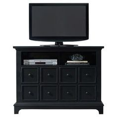 Hardwood entertainment console with two doors and two open areas.  Product: Entertainment consoleConstruction Material: Hardwood solids and veneersColor: BlackFeatures:  Two open areasTwo doors with one adjustable shelf behind each Dimensions: 34 H x 45 W x 20 D