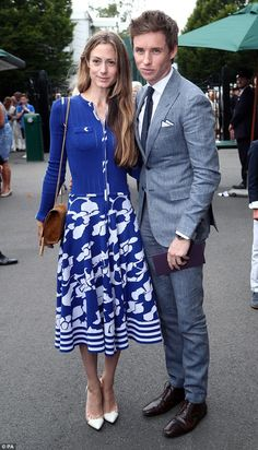 Dapper:Eddie Redmayne, 35, led the A-list pack as he stepped out in a dapper grey suit layered over a crisp white shirt for the Wimbledon Men's Singles Final on Sunday