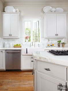 Forget about adding soffits above your cabinets. Instead, leave wall space wide open so you can take advantage of cabinet tops for displaying handsome accessories. These open-to-view areas are ideally suited to spotlighting statuesque serving pieces that often go unseen and unappreciated when stored behind closed doors.