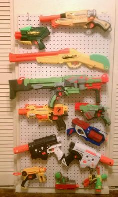 Nerf Gun Rack...Total cost $12!  My hubby is so proud to have made this for Will! =)