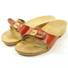 Dr Scholl's Wooden Clogs.  I always clunked my own heel with the other shoe as I walked or I would fall off of the darn thing (it hurt too!)