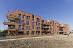 Lekkerkerk, Parkflat - The apartment building 'Parkflat' consists of forty-two apartments, fit for lifelong inhabitation, in the social rental sector. In the Parkflat autonomous living and care are combined. The building consists of 4 layers with 12 apartments per layer, connected by a corridor. The building's brick façade is enriched by a variety of balconies, all with brick parapets. All windows are fitted with sunscreens, hidden behind the brickwork.