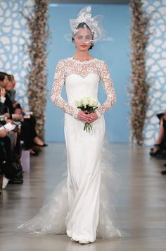 A blusher veil with matching lace appliques will deliver elegance while letting the dress do the talking.