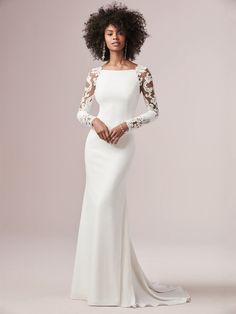Minimalist crepe long sleeve lace sheath wedding dress. Beautiful illusion cut-out sleeves accent this sleek and classy Chardon crepe wedding dress complete with a bateau neckline and sheath silhouette. Bethany is available at the Atlas Bridal Shop. Atlas Bridal Shop is a bridal & wedding dress shop in Toledo, Ohio. Dress designers include Morilee, Allure Bridal, Allure Couture, Maggie Sottero, Rebecca Ingram, Sottero Midgely, Jade, Jade Couture, Cameron Blake, Montage, MGNY and more. Sleek Wedding Dress, Crepe Wedding Dress, Long Wedding Dresses, Designer Wedding Dresses, Wedding Gowns, Wedding Tuxedos, Affordable Wedding Dresses, Modest Wedding, Lace Wedding