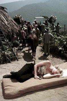 Grace Kelly takes a nap on the set of Green Fire, 1954.