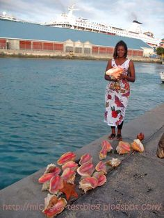 Beautiful girl selling conch shells - Bahamas Nassau i so want to get one when im there