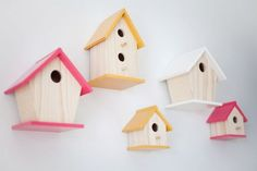 yellow pink girl nursery features birdhouses as wall art bird house collage on wall with roof tops painted pink and yellow