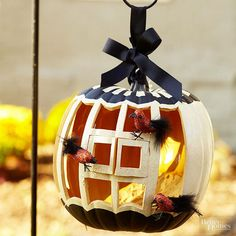 How pretty would this birdcage look hanging from your shepherd's crook? Very pretty, in our opinion! We strung up this pretty carved birdcage with ribbon for an extra-elegant display and posed miniature birds around the pumpk/
