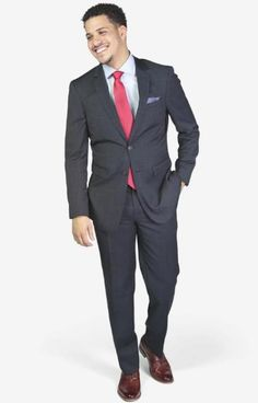 Suit includes jacket & trousers 2-button single breast jacket Notch lapels Flap pockets Side vents Suit includes jacket & trousers Fit: Slim Fit Comfort: Stretch Armhole for comfort Material: 98% Wool 2% Spandex Color: Navy