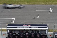 Daniil Kvyat (RUS) Red Bull Racing RB11 passes the Red Bull Racing engineers on the pitwall gantry at Formula One Testing, Day Three, Barcelona, Spain, 21 February 2015