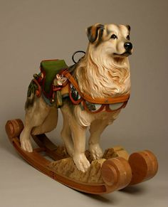 TIM RACER is a woodcarving artist who crafts custom dog rockers & carousel animals from basswood, on commission by the pet owner. Racer always takes time to meet the dog, often travelling hundreds of miles, just so he can capture the true essence of the canine before beginning work on a piece / Seen here: Sataf Australian Shepherd, possibly mixed with husky / http://www.timracer.com