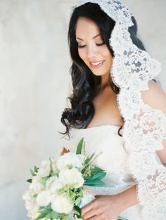 Lovely lace veiled bride: http://www.stylemepretty.com/2014/04/08/organic-garden-affair-in-san-juan-capistrano/ | Photography: Erich McVey - http://www.erichmcvey.com/
