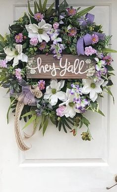 "Spring Wreath, Spring Door Wreath, Spring and Summer Wreath, Sassy Doors Wreath, Home and Living, Deco Mesh Wreath. Beach Wreath, Sassy Southern Decor, Cream Magnolias Designed on a 24 inch evergreen wreath and measures approximentaly 27 wide and 34"" long Beautifully accented with"