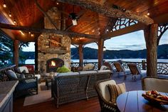 Covered Porch - what a fun place; this might work with the bunkhouse at S.L. cabin...  The huge covered porch with its incredible tree-trunk beams and posts acts like an outdoor great room and includes a large stone fireplace, multiple lounging areas and a dining table.....
