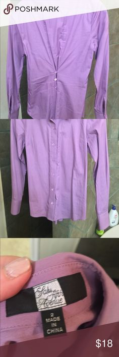 Saks fifth Avenue button down Lavender colored button down shirt with button back to accentuate the waist, very unique and never worn Saks Fifth Avenue Tops Button Down Shirts