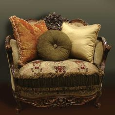 Our popular Isabella chair frames is made of solid wood with outstanding hand-carving  Down-blend, medium-firm cushions, with three accent pillows.  Antique walnut hand-rubbed satin finish with gold accents.<br>   <br /><br /><strong>This group is only available as shown </strong><br /> <br /><br /> [$1,999.95]