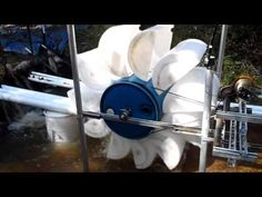 This is the second water wheel I made.....The first had buckets cut in half for scoops...This one has 25 gal barrels cut in half for scoops...It may move slo...