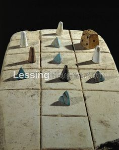 Limestone game board with faience pawns. Games such as this one were popular in Egypt and Canaan. Board Games, Egypt, Popular, Image, Decor, Role Playing Board Games, Decoration, Decorating, Tabletop Games