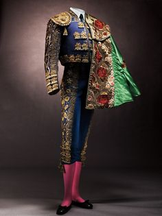 Traje de luces (bullfighter's suit) by Fermín, c. 1950s-1960s and Capote de paseo (bullfighter's ceremonial cape), c. 1940s; both worn by Carlos Arruza