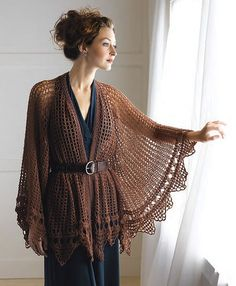 This pattern from Ravelry: Shimmer Beaded Lace Cape pattern by Kristin Omdahl is gorgeous!