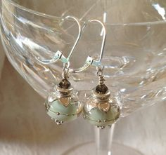 Hey, I found this really awesome Etsy listing at https://www.etsy.com/listing/159907353/gorgeous-light-green-lampwork-earrings