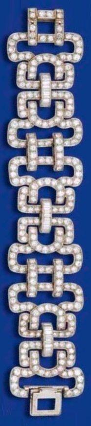 AN ART DECO DIAMOND BRACELET, CIRCA 1930. Of openwork design, the six…