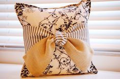 Great design - will use my basic brown pillows and create bows using seasonal fabric. Great, inexpensive way to decorate without buying pillows for every season