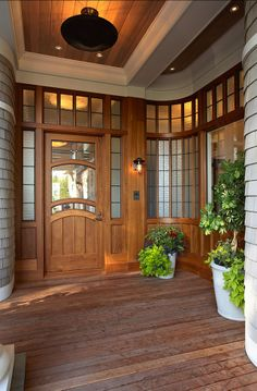 front door / porch gorgeous! (wooden deck for water to drain?) stunning.