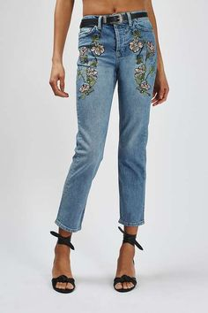 The must-have fit of the season, the MOTO straight leg jean comes crafted in our authentic low stretch denim. In a comfortable mid-rise fit, they are cropped to the ankle with a tapered leg and feature a pretty floral embroidery. We love them styled with a turned hem, for an edgy feel. #Topshop