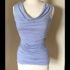 ⬇️REDUCED⬇️Blue sleeveless top Grayish/blue sleeveless top with gathered material in mid area and draped neck style. Made of 96% rayon, 4% spandex. Lining is 100% polyester. Carmen Marc Valvo Tops