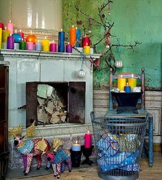 The collection of bright coloured candles is stunning! (Dishfunctional Designs: A Beautiful Bohemian Christmas) Love all the different colored candles! I usually just use the typical red, green, and brown candles! Bohemian Christmas, Noel Christmas, Christmas Crafts, Christmas Ideas, Christmas Glitter, Rustic Christmas, Beautiful Christmas, Christmas Ornaments, Bohemian Decoration
