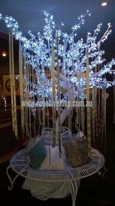 White cherry blossom LED tree with French provincial surround seat. Sage and silver diamontie styling. www.creativeloop.com.au/led-tree-hire.html