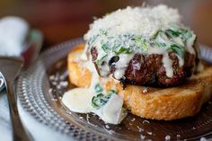 Steakhouse mushroom burgers with creamed spinach sauce. You could serve a shoe to me on Texas toast and I'd eat it, but with this I won't have to.
