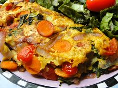 Chickpea Omelette - INGREDIENTS:  Chickpea flour, baking powder, water, nutritional yeast, assorted veggies, salt and pepper to taste and coconut oil for frying.. but unnecessary with non stick pan.