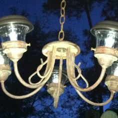 Repurposed light fixture with solar lights for outdoor area