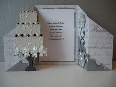 Beautiful wedding card....I like the little cake for a scrapbook page