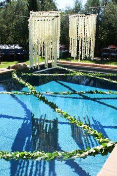 Interesting garland crossing the pool - Wedding pool decorations