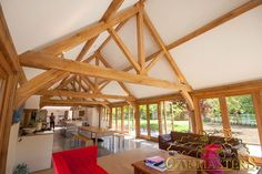 King Oak post trusses and open vaulted ceilings by Oakmasters for a solid construction, elegance and luxury.