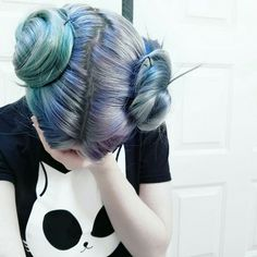 Grunge dyed turquoise and blue hair with buns