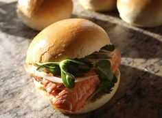 Olive oil three ways.  Grilled, fresh, wild salmon drizzled with Frantoio olive oil, served with lemon agrumato aioli tartar sauce, on a fresh baked Cobrancosa olive oil roll, with foraged purslane.