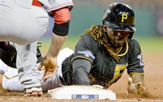 Pittsburgh Pirates' Andrew McCutchen (22) dives back to first on a pickoff attempt in the fourth inning. (Don Wright/AP)