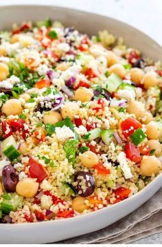 Mediterranean couscous salad with a fresh lemon herb dressing. Semolina pasta to… Mediterranean couscous salad with a fresh lemon herb dressing. Semolina pasta tossed with colorful vegetables, feta cheese, olives, and garbanzo beans. Mediterranean Couscous, Mediterranean Diet Recipes, Mediterranean Breakfast, Mediterranean Chicken, Best Salad Recipes, Summer Salad Recipes, Summer Vegetable Recipes, Grilled Vegetable Salads, Chickpea Salad Recipes